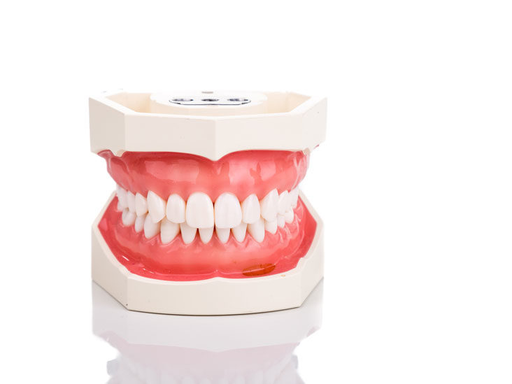 Why do my bottom teeth feel tight